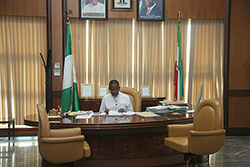 Governor-Okowa-working-on-some-files-on-his-desk.jpg