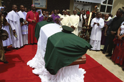 Clergymen-surround-the-casket-of-Biafran-ex-warlord-Chukwuemeka-Odumegwu-Ojukwu-at-St.-Micheal-Catholic-church-during-his-final-funeral-ceremony-in-his-native-village-of-Nnewi.-REUTERS-PICTURES..2.jpg