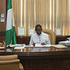 THUMB-Governor-Okowa-working-on-some-files-on-his-desk.jpg